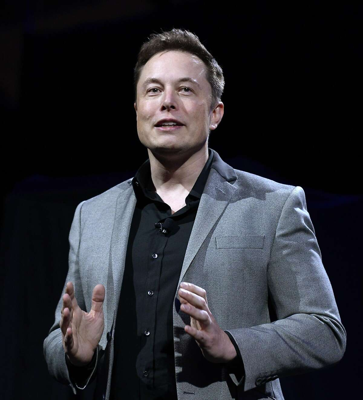 Elon Musk, CEO of Tesla, unveils suit of batteries for homes, businesses, and utilities at Tesla Design Studio April 30, 2015 in Hawthorne, California.