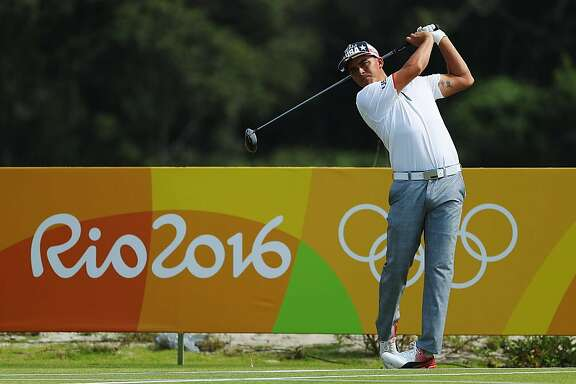 RIO DE JANEIRO, BRAZIL - AUGUST 09:  Rickie Fowler of the United States watches a tee shot during a practice round on Day 4 of the Rio 2016 Olympic Games at Olympic Golf Course on August 9, 2016 in Rio de Janeiro, Brazil.  (Photo by Scott Halleran/Getty Images)