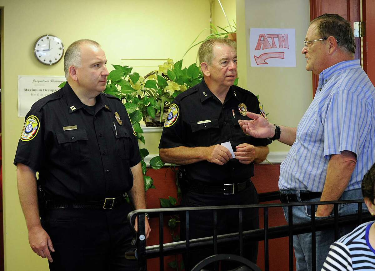 """Bethel Police Captian Stephen Pugner, left, Chief Jeffrey Finch, chat with town resident Lawrence Bocchiere III at Jacqueline's Restaurant on Wednesday morning, August 10, 2016. Bocchiere was interested in traffic issues and handicapped parking. The Bethel police held what they called a """"Coffee with a Cop"""" event to allow members of the community to get to know them."""
