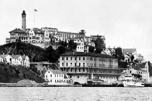 """View dated 1930's of the Alcatraz island and penitentiary, in the San Francisco Bay. From the mid 1930's until the mid 1960's, Alcatraz (""""the Rock"""") was America's premier maximum-security prison, the final stop for the nation's most incorrigible inmates, including Al Capone. (Photo credit should read -/AFP/Getty Images)"""