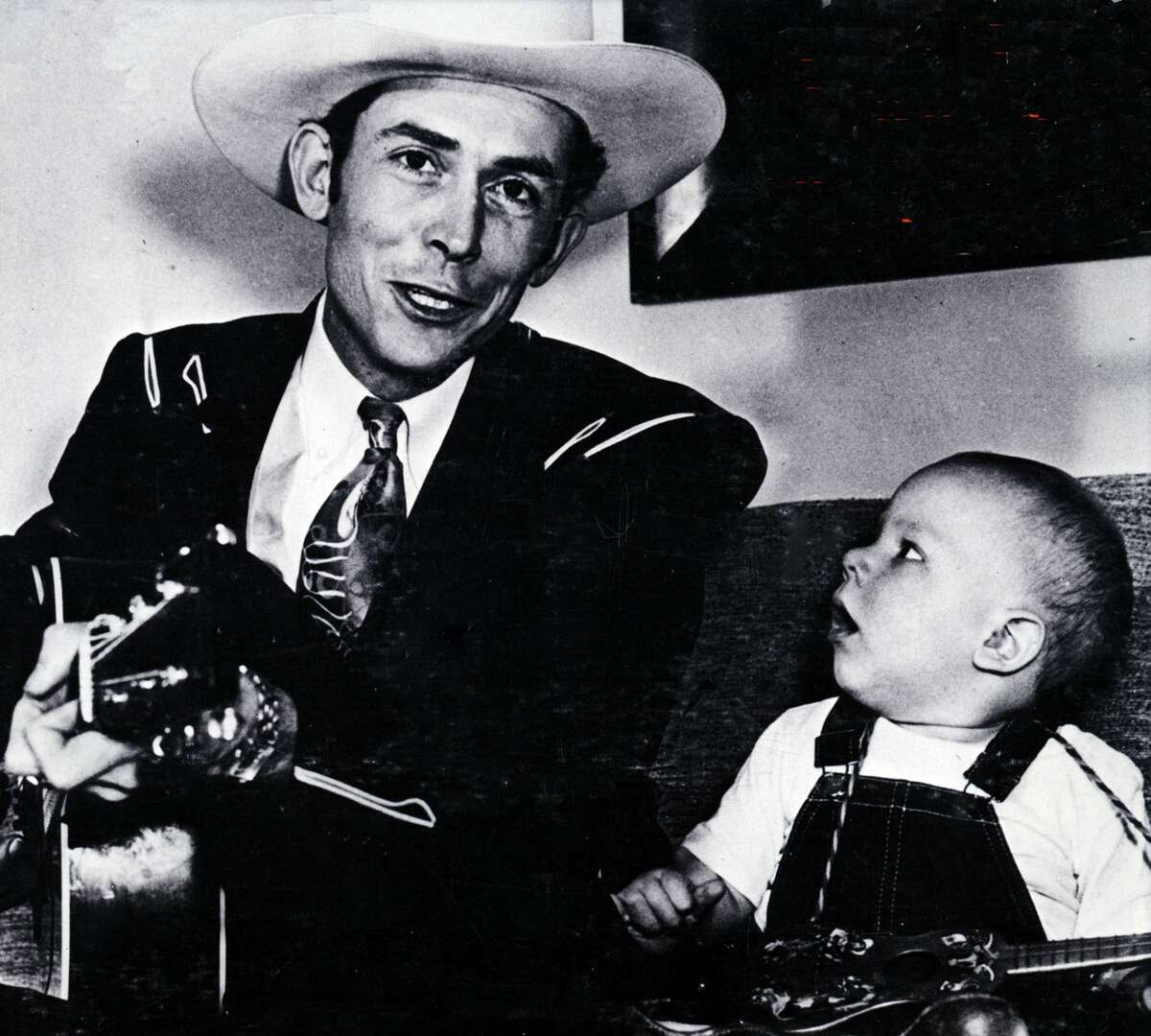 UNSPECIFIED - JANUARY 01: (AUSTRALIA OUT) Photo of Hank WILLIAMS Jnr and Hank WILLIAMS; With son Hank Williams jr (Photo by GAB Archive/Redferns)