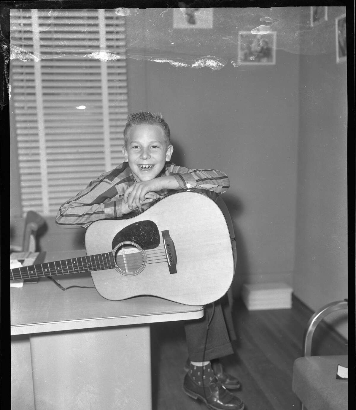 UNITED STATES - CIRCA 1958: Hank Williams JR, TD with guitar. Location uncertain, Nashville, Tennessee. Very late 1950s or very early1960s. (Photo by Elmer Williams/Country Music Hall of Fame and Museum/Getty Images)