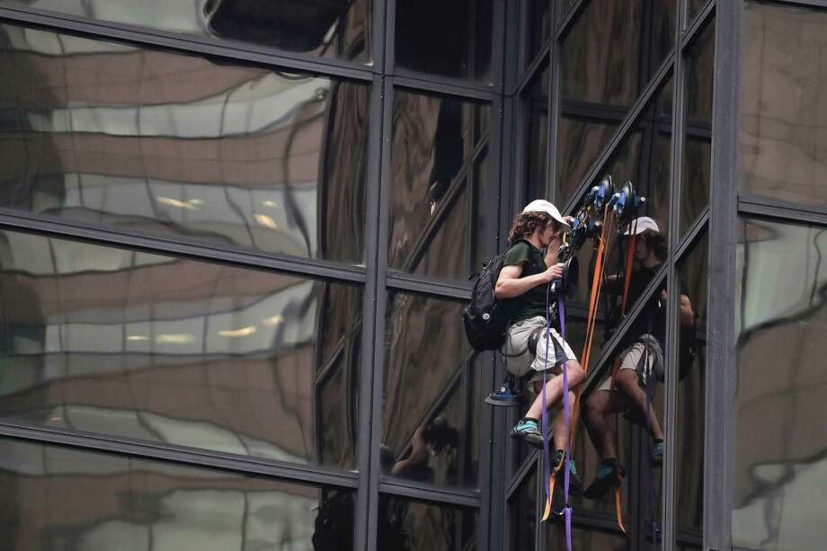 A man scales the all-glass facade of Trump Tower using suction cups Wednesday, Aug. 10, 2016, in New York. A police spokeswoman says officers responded to Donald Trump's namesake skyscraper on Fifth Avenue. The 58-story building is headquarters to the Republican presidential nominee's campaign. He also lives there. Photo: Julie Jacobson, AP / Copyright 2016 The Associated Press. All rights reserved. This material may not be published, broadcast, rewritten or redistribu