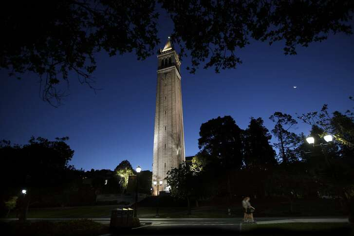 Early morning joggers pass the Campanile on the campus of the University of California at Berkeley, in a September 2015 file image. School administrators are leading an ambitious effort to reshape the nation's premier public research institution, but they are facing increasingly fierce reactions from their usual allies -- the faculty. (Bob Chamberlin/Los Angeles Times/TNS)