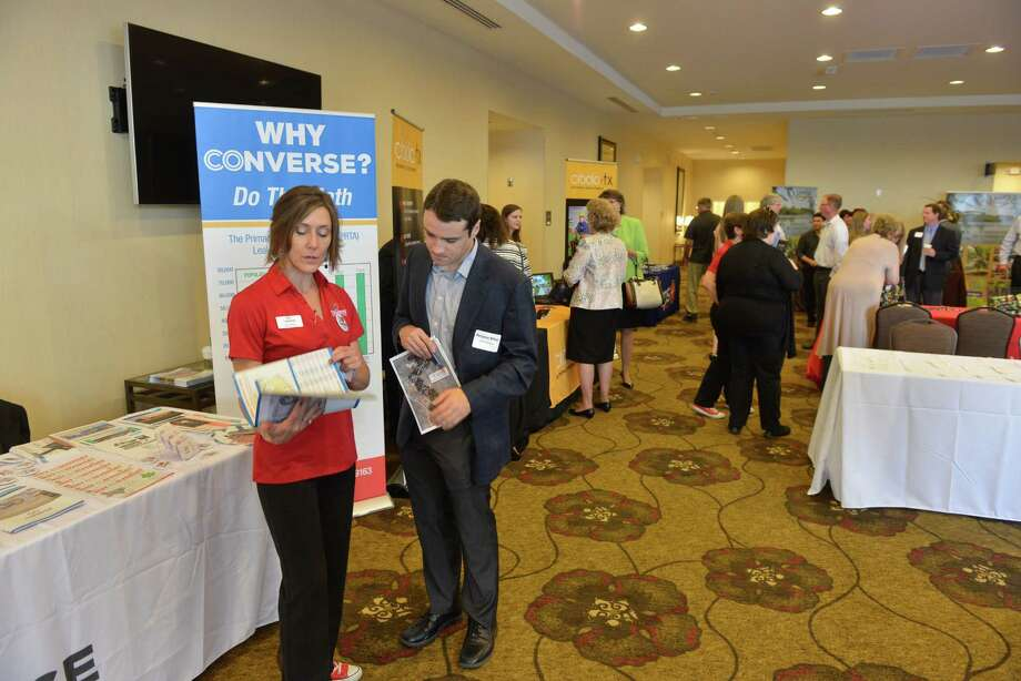 Kat Lindquist, the Business Retention and Marketing Manager for Converse Tx. speaks with Benjamin Bittner of the Industrial Group Southwest  before the Northeast Partnership Cities for Economic Development  event in Universal City Wednesday. Photo: Robin Jerstad / San Antonio Express-News