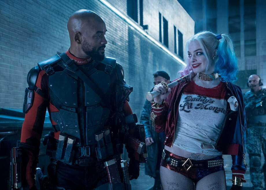 "The ""Suicide Squad"" reviews have been savage and fan response tepid, so of course followers of the DC Extended Universe directed their anger at ... a website that statistically evaluates critical response? Deadshot himself might consider that off the mark. Pictured: Will Smith as Deadshot (left) and Margot Robbie as Harley Quinn (right, in case you couldn't guess). Photo courtesy of Warner Bros. Entertainment and Ratpac-Dune Entertainment. Photo: Warner Bros. Entertainment"