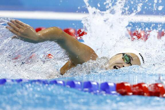 Refugee Olympic Team's Yusra Mardini competes in a Women's 100m Freestyle heat during the swimming event at the Rio 2016 Olympic Games at the Olympic Aquatics Stadium in Rio de Janeiro on August 10, 2016.   / AFP PHOTO / Odd AndersenODD ANDERSEN/AFP/Getty Images