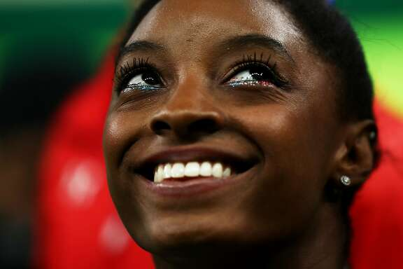 RIO DE JANEIRO, BRAZIL - AUGUST 09:  Simone Biles of the United States looks on during the Artistic Gymnastics Women's Team Final on Day 4 of the Rio 2016 Olympic Games at the Rio Olympic Arena on August 9, 2016 in Rio de Janeiro, Brazil.  (Photo by Lars Baron/Getty Images)