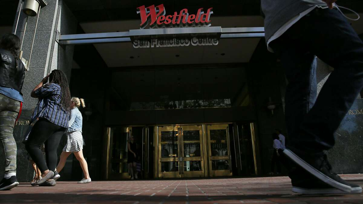 Pedestrians on Market Street walk past an entrance to Westfield San Francisco Centre in this file photo from September 25, 2015 in San Francisco, Calif. Police reported that three men were found in the emergency stairwell of the mall on Sunday, carrying scary clown masks and a gun.