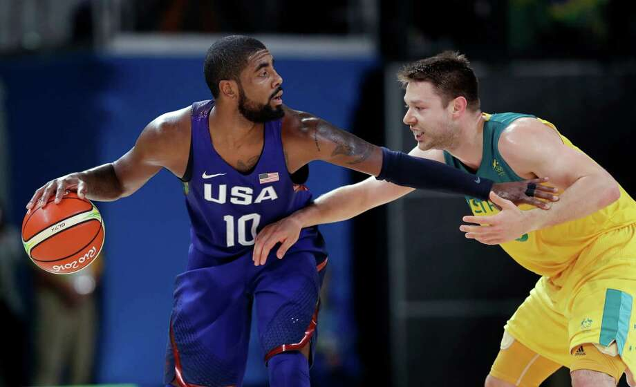 United States' Kyrie Irving (10) drives around Australia's Matthew Dellavedova during a basketball game at the 2016 Summer Olympics in Rio de Janeiro, Brazil, Wednesday, Aug. 10, 2016. Photo: Charlie Neibergall, AP / Copyright 2016 The Associated Press. All rights reserved. This material may not be published, broadcast, rewritten or redistribu