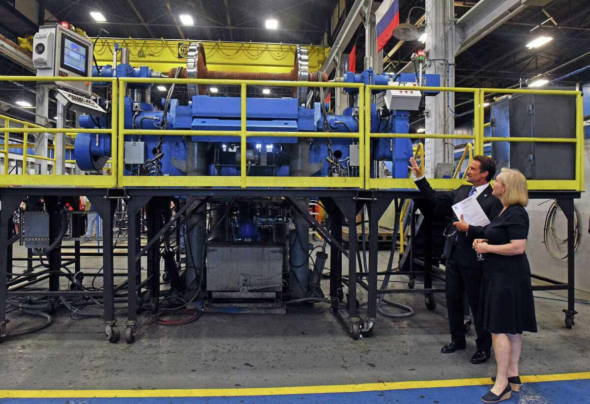 U.S. Senator Kirsten Gillibrand tours Simmons Machine Tool Corporation with company President and COO David William Davis on Wednesday Aug. 10, 2016 in Menands, N.Y. (Michael P. Farrell/Times Union)