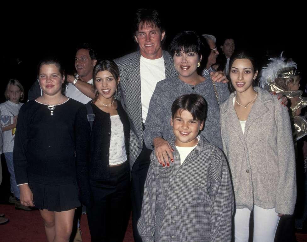 October 1995: Khloe Kardashian, Kourtney Kardashian, Bruce Jenner, Kris Kardashian, Robert Kardashian and Kim Kardashian attend Cinderella on video release party. (Photo by Ron Galella, Ltd./WireImage)