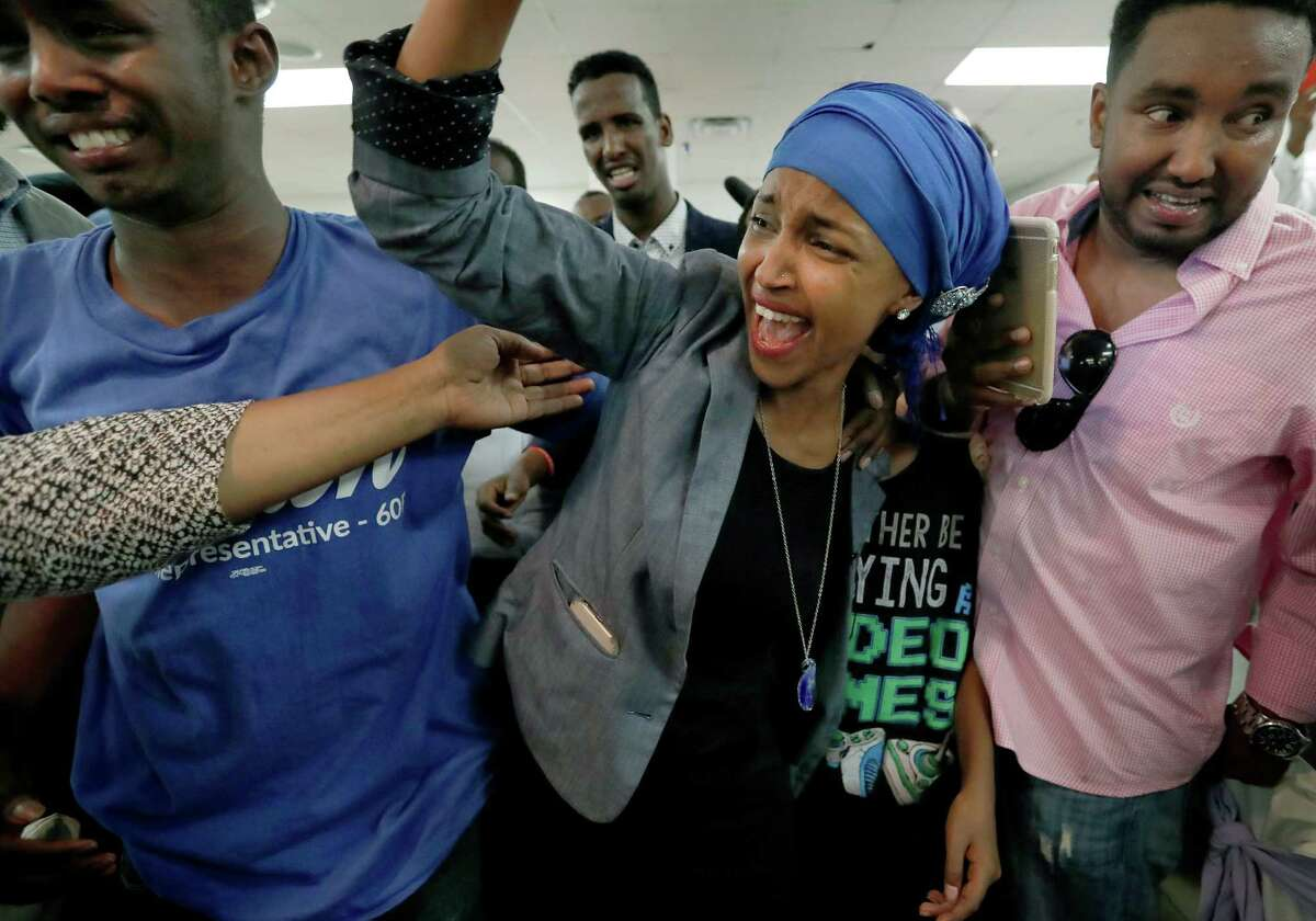 Somali activist Ilhan Omar is greeted by supporters at Kalsan Tuesday, Aug. 9, 2016, in Minneapolis. Omar defeated 22-term Rep. Phyllis Kahn in Tuesday's nominating contest in the heavily Democratic Minneapolis district. (Carlos Gonzalez/Star Tribune via AP) ORG XMIT: MNMIT102