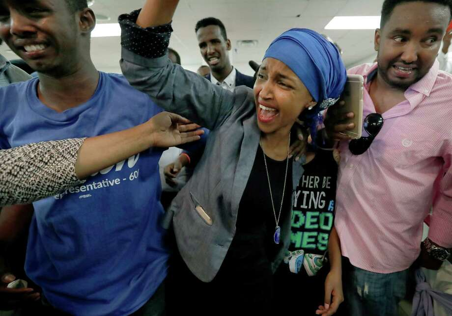 Somali activist Ilhan Omar is greeted by supporters at Kalsan Tuesday, Aug. 9, 2016, in Minneapolis. Omar defeated 22-term Rep. Phyllis Kahn in Tuesday's nominating contest in the heavily Democratic Minneapolis district. (Carlos Gonzalez/Star Tribune via AP) ORG XMIT: MNMIT102 Photo: Carlos Gonzalez / Star Tribune