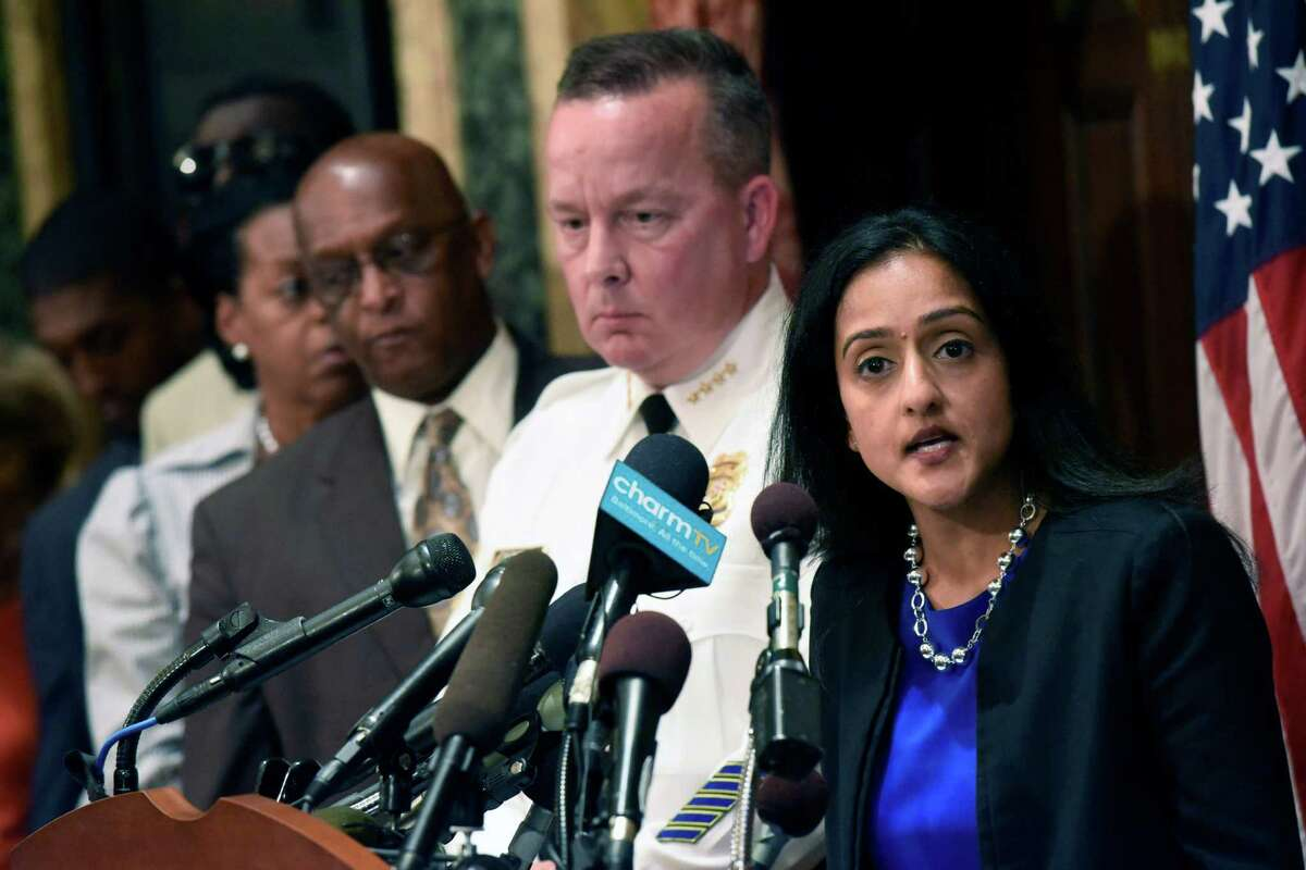 Principal Deputy Assistant Attorney General Vanita Gupta, right, speaks during a news conference as Police Commissioner Kevin Davis, second from right, and City Council president Bernard C. Jack Young listen at City Hall in response to a Justice Department report, Wednesday, Aug. 10, 2016 in Baltimore. The Justice Department and Baltimore police agreed to negotiate court-enforceable reforms after a scathing federal report released Wednesday criticized officers for using excessive force and routinely discriminating against blacks. (Kim Hairston/The Baltimore Sun via AP) ORG XMIT: MDBAE102
