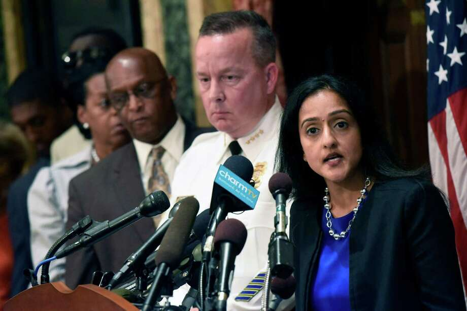 Principal Deputy Assistant Attorney General Vanita Gupta, right, speaks during a news conference as Police Commissioner Kevin Davis, second from right, and City Council president Bernard C. Jack Young listen at City Hall in response to a Justice Department report, Wednesday, Aug. 10, 2016 in Baltimore. The Justice Department and Baltimore police agreed to negotiate court-enforceable reforms after a scathing federal report released Wednesday criticized officers for using excessive force and routinely discriminating against blacks. (Kim Hairston/The Baltimore Sun via AP) ORG XMIT: MDBAE102 Photo: Kim Hairston / The Baltimore Sun