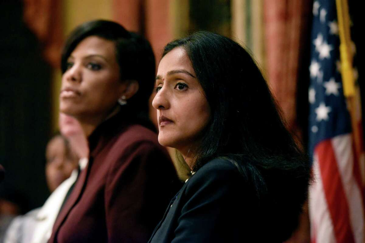 Baltimore Mayor Stephanie Rawlings-Blake, left, and Principal Deputy Assistant Attorney General Vanita Gupta listen to a question during a news conference at City Hall in response to a Justice Department report, Wednesday, Aug. 10, 2016 in Baltimore. The Justice Department and Baltimore police agreed to negotiate court-enforceable reforms after a scathing federal report released Wednesday criticized officers for using excessive force and routinely discriminating against blacks. (Kim Hairston/The Baltimore Sun via AP) ORG XMIT: MDBAE103