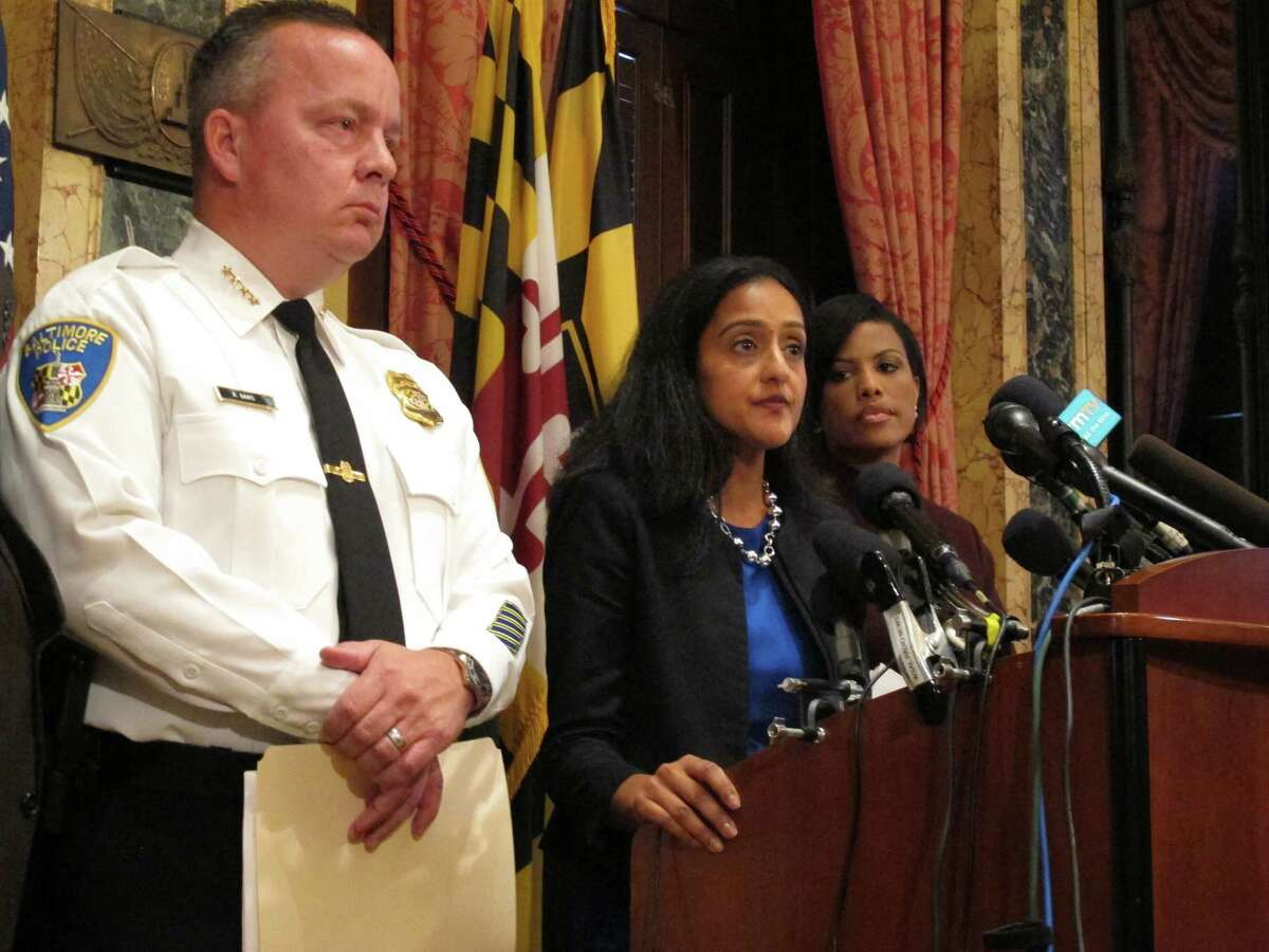 Vanita Gupta, head of the Justice Department's Civil Rights Division, discusses the department's findings on the investigation into the Baltimore City Police Department as Police Commissioner Kevin Davis, left, and Mayor Stephanie Rawlings-Blake, right, listens on Wednesday, Aug. 10, 2016 at City Hall in Baltimore. The Justice Department and Baltimore police agreed to negotiate court-enforceable reforms after a scathing federal report released Wednesday criticized officers for using excessive force and routinely discriminating against blacks. (AP Photo/Brian Witte) ORG XMIT: RPBW101