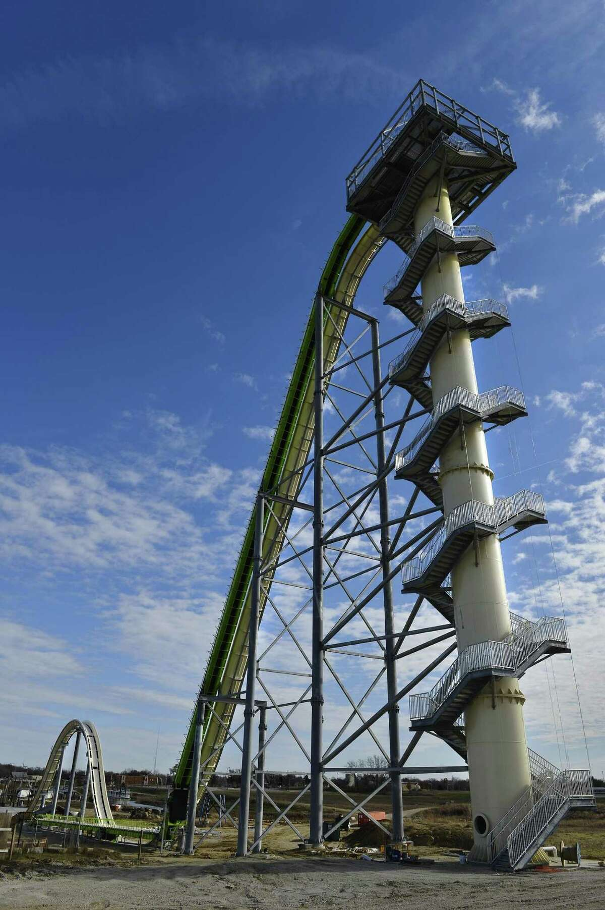 FILE - This Nov. 2013 file photo shows Schlitterbahn's new Verruckt speed slide/water coaster in Kansas City, Kan. A 12-year-old boy died Sunday, Aug. 7, 2016, on the Kansas water slide that is billed as the world's largest, according to officials. Kansas City, Kan., police spokesman Officer Cameron Morgan said the boy died at the Schlitterbahn Waterpark, which is located about 15 miles west of downtown Kansas City, Missouri. Schlitterbahn spokeswoman Winter Prosapio said the child died on one of the park's main attractions, Verruckt, a 168-foot-tall water slide that has 264 stairs leading to the top. (Jill Toyoshiba/The Kansas City Star via AP, File) ORG XMIT: MOKAS200