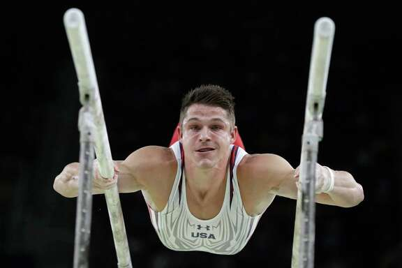 American Chris Brooks gives it his best shot on the parallel bars during the men's individual all-around final Wednesday.