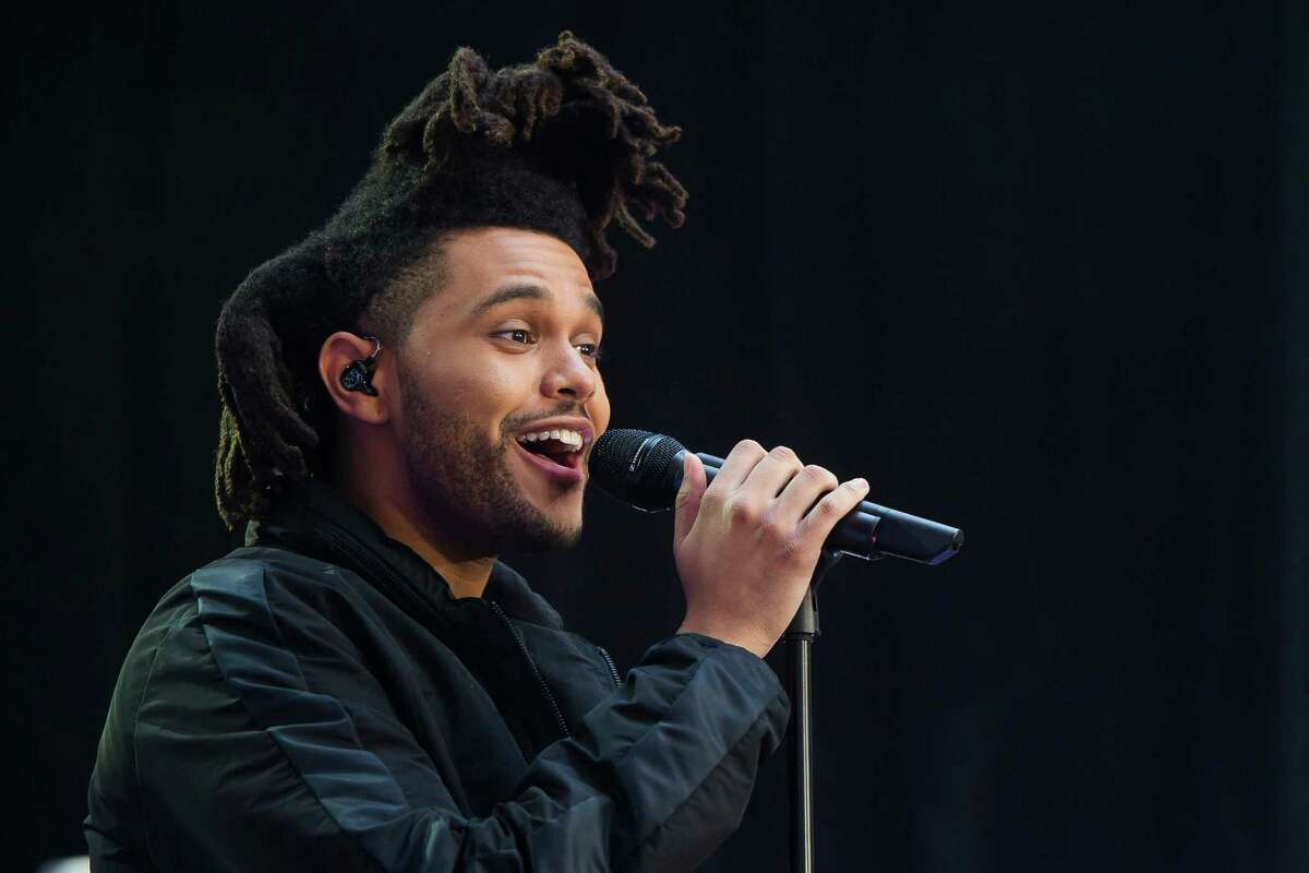FILE - In this May 7, 2015 file photo, Abel Tesfaye, known by his stage name The Weeknd, performs on NBC's