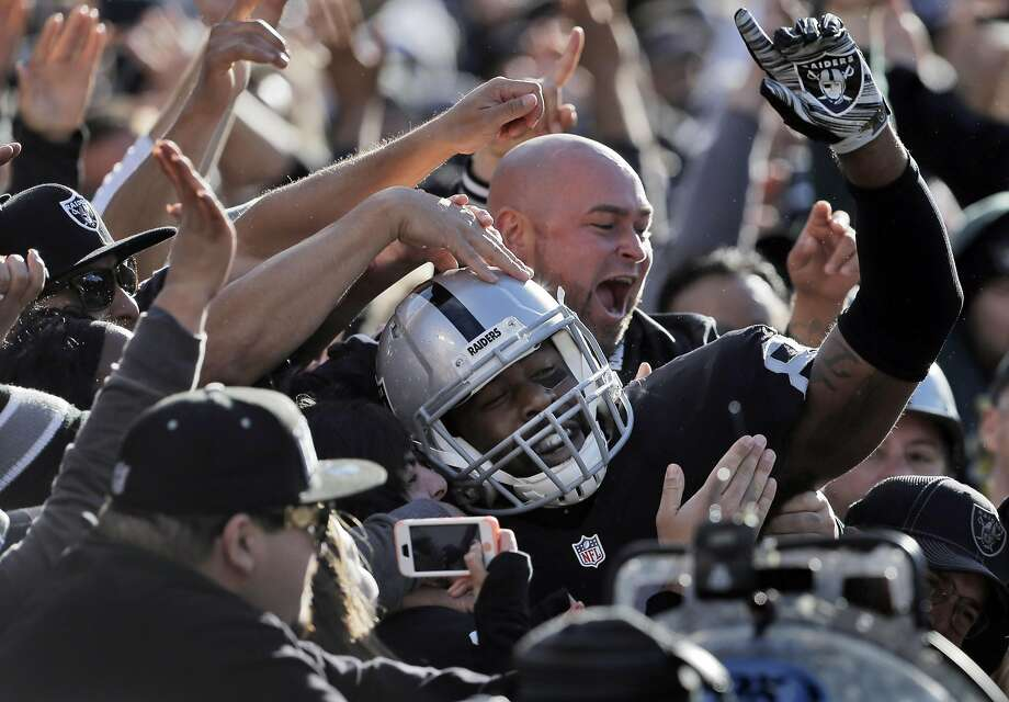 Clive Walford (88) leaps into the black hole after scoring a touchdown in the first half as the Raiders played the Minnesota Vikings at O.co Coliseum in 2015. . Photo: Carlos Avila Gonzalez, The Chronicle