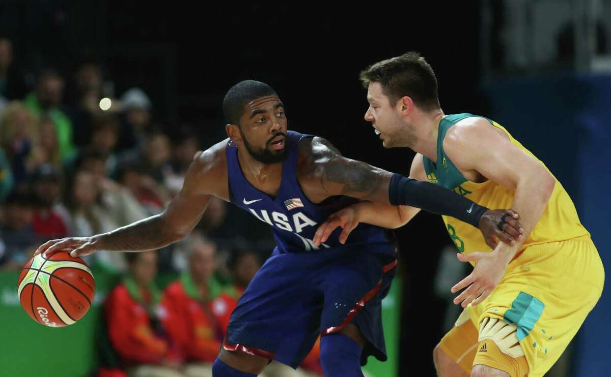 RIO DE JANEIRO, BRAZIL - AUGUST 10: Kyrie Irving #10 of United States handles the ball against Matthew Dellavedova #8 of Australia during the Men's Preliminary Round Group A game between Australia and the United States on Day 5 of the Rio 2016 Olympic Games at Carioca Arena 1 on August 10, 2016 in Rio de Janeiro, Brazil. (Photo by Phil Walter/Getty Images) ORG XMIT: 610598199