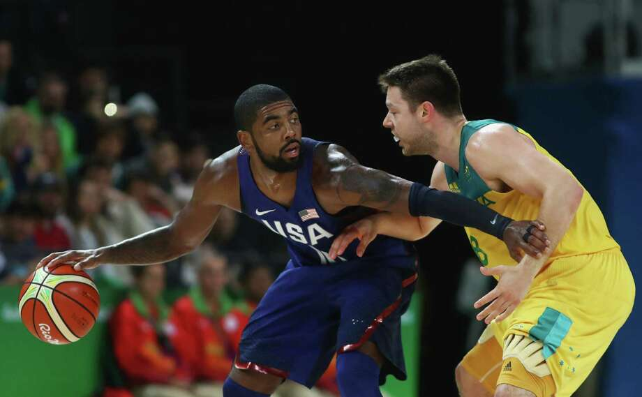 RIO DE JANEIRO, BRAZIL - AUGUST 10:  Kyrie Irving #10 of United States handles the ball against Matthew Dellavedova #8 of Australia during the Men's Preliminary Round Group A game between Australia and the United States on Day 5 of the Rio 2016 Olympic Games at Carioca Arena 1 on August 10, 2016 in Rio de Janeiro, Brazil.  (Photo by Phil Walter/Getty Images) ORG XMIT: 610598199 Photo: Phil Walter / 2016 Getty Images
