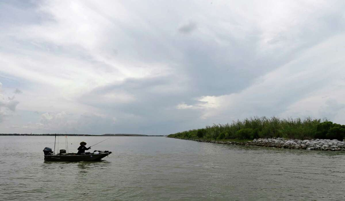 A fisherman is shown near Atkinson Island in the Upper Galveston Bay Wednesday, Aug. 10, 2016. A grade of C was issued in the Galveston Bay Report Bay as to the overall heath of the Galveston Bay. Atkinson Island is man made wetland project, created using dredged materials. The report is present by The Galveston Bay Foundation (GBF) and the Houston Advanced Research Center (HARC).