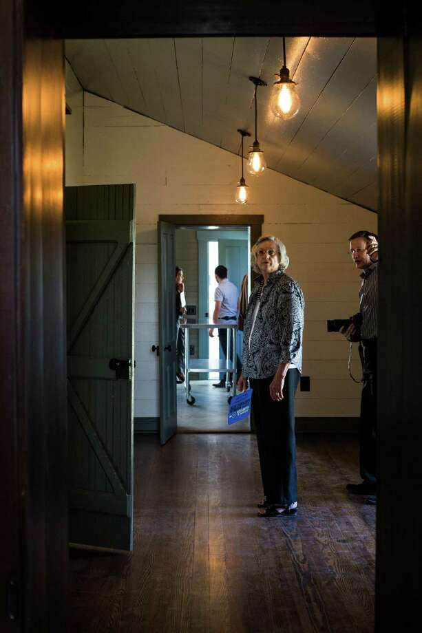 Carol Carpenter studies the room as her son, Scott Carpenter, shows her around during the public opening of the John S. Harrison House in Selma, on Wednesday, August 10, 2016. The house, built in 1852, is on the National Registry of Historic Places and was recently part of a $1.2 million restoration project. Scott of 7th Generation Design in San Antonio, was the architect on the project and it was his mother's first visit. Photo: BRITTANY GREESON, Staff / San Antonio Express-News / © 2016 San Antonio Express-News