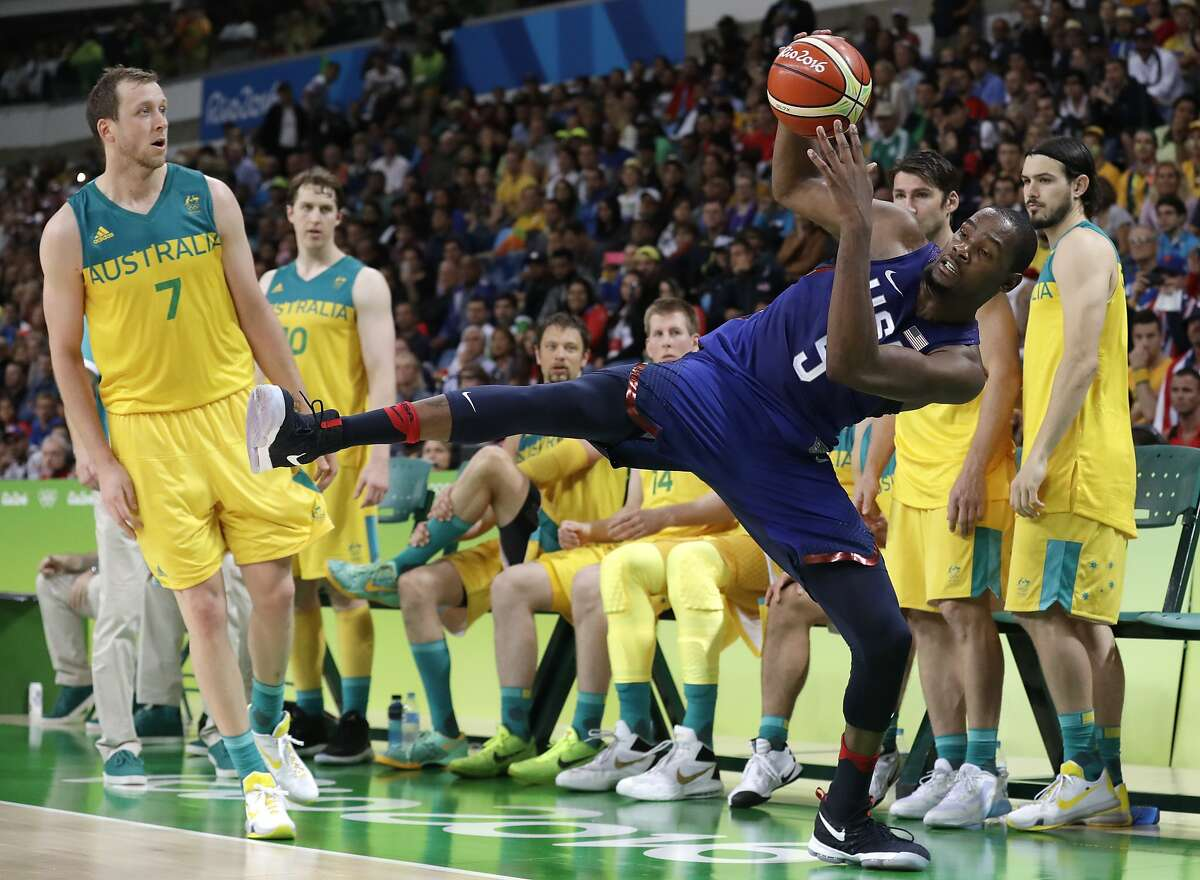 United States' Kevin Durant (5) is fouled by Australia's Joe Ingles (7) during a basketball game at the 2016 Summer Olympics in Rio de Janeiro, Brazil, Wednesday, Aug. 10, 2016. (AP Photo/Charlie Neibergall)