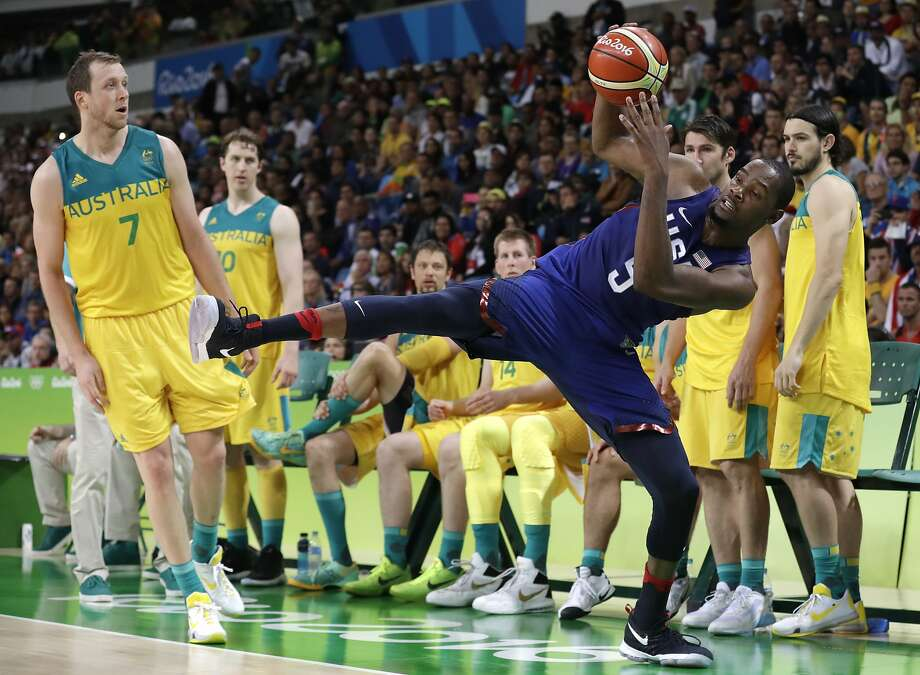 United States' Kevin Durant (5) is fouled by Australia's Joe Ingles (7) during a basketball game at the 2016 Summer Olympics in Rio de Janeiro, Brazil, Wednesday, Aug. 10, 2016. (AP Photo/Charlie Neibergall) Photo: Charlie Neibergall, Associated Press