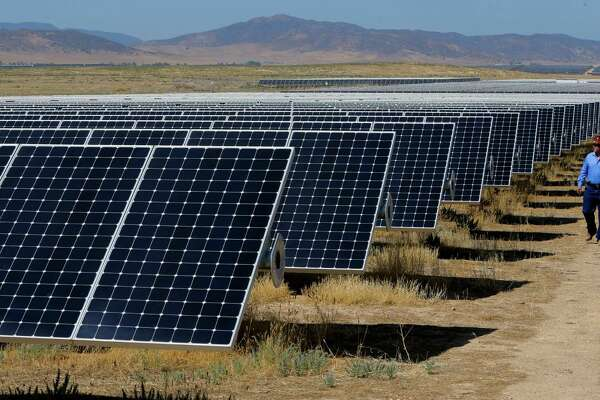 The California Valley Solar Farm near Santa Margarita, Calif., has 749,088 solar panels. Because of a shift in tax policy at the end of 2015, big solar plant deals are slowing.