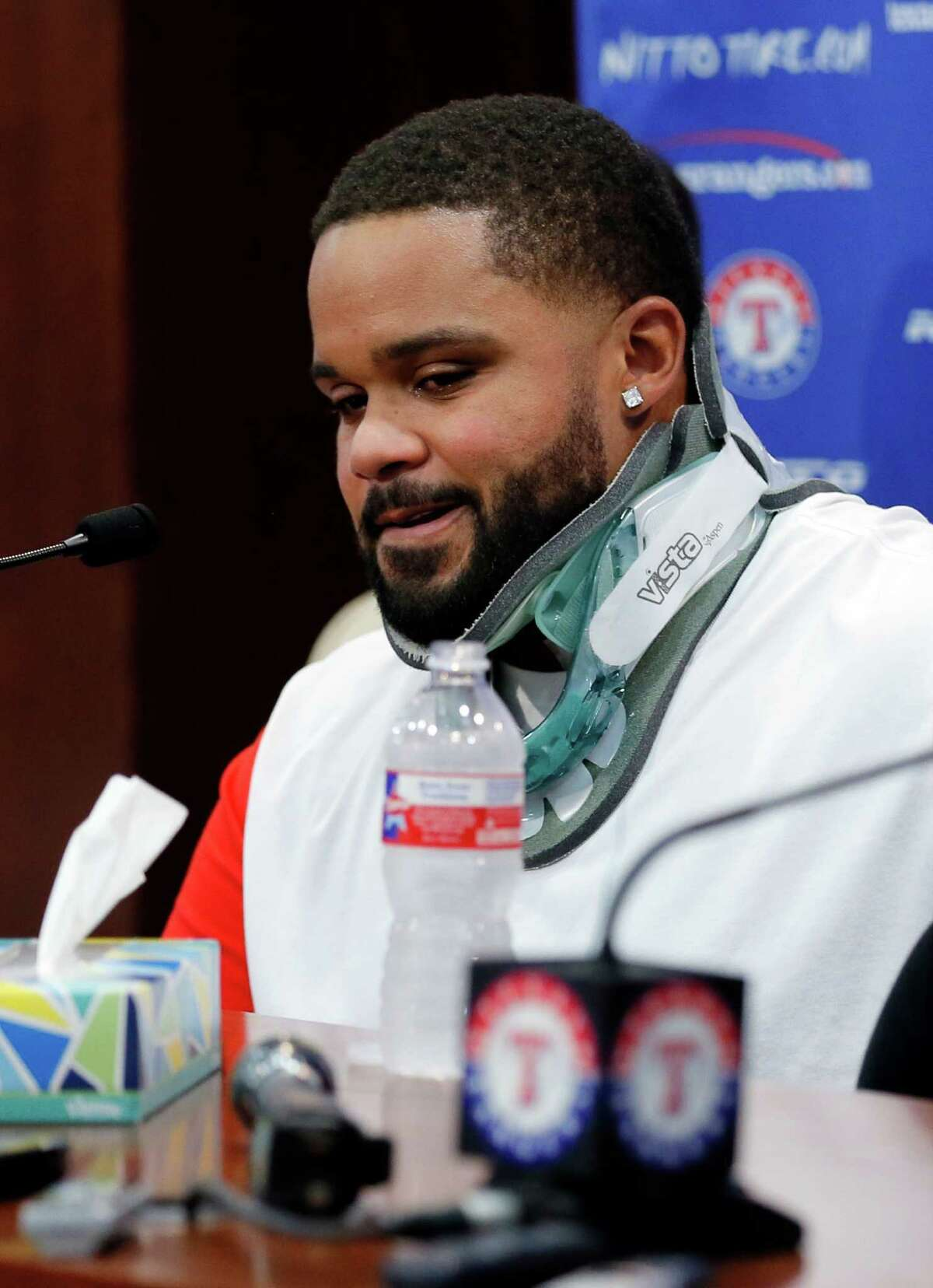 Texas Rangers' Prince Fielder pauses as he makes comments during a news conference before a baseball game against the Colorado Rockies, Wednesday Aug. 10, 2016, in Arlington, Texas. Fielder will not be able to come back after a second neck surgery. The Rangers slugger wept Wednesday as he said health issues were forcing him to end his 12-season major league career. (AP Photo/Tony Gutierrez) ORG XMIT: ARL102