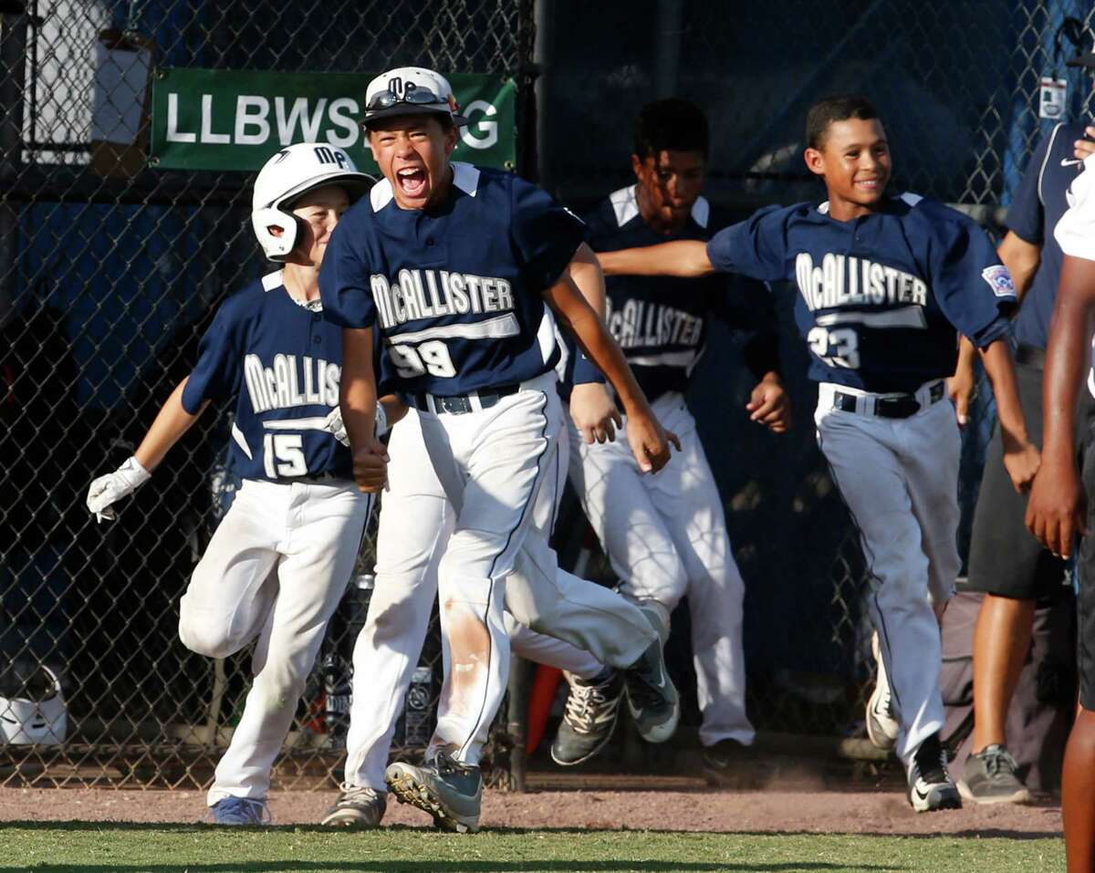 Orion Medina exults after Blake Compton's home run in the second inning of McAllister Park's 13-3 victory over Eastdale, N.M., in the Southwest Regional championship Wednesday in Waco.