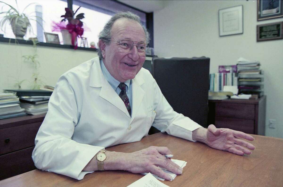 Dr. Emil Freireich, shown in this 1997 file photo in his office at M.D. Anderson Hospital, died Monday.