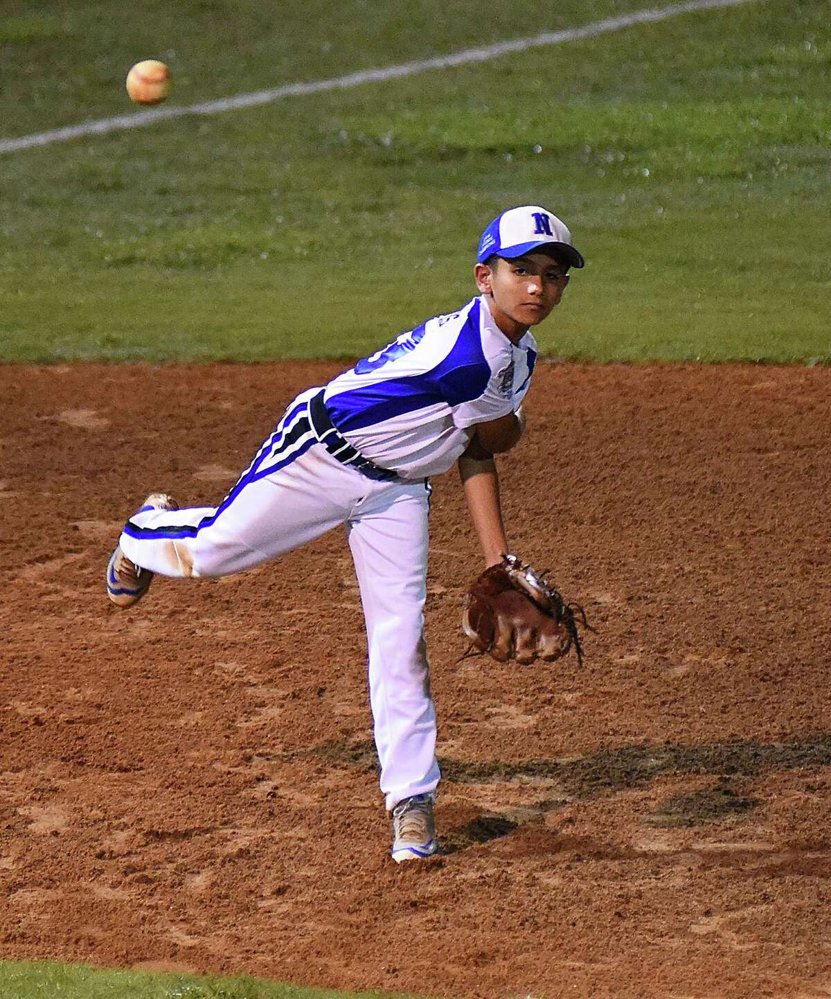 Norwalk third baseman Taso Panagiotidis comes up throwing to first base during Wednesday's Cal Ripken 10-year-old World Series quarterfinal against East Lake Baseball of South Bend, Ind.