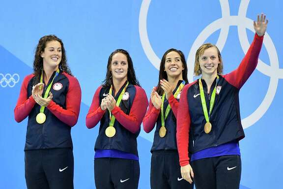 The United States' Katie Ledecky, right, turned a 0.89-second deficit into 1.84-second victory as the anchor of the women's 800-meter  freestyle relay to help lift teammates Allison Schmitt (from left), Leah Smith and Maya DiRado to gold Wednesday in Rio de Janeiro.