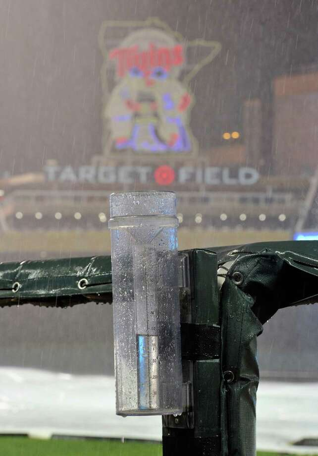 MINNEAPOLIS, MN - AUGUST 10: Rain falls at Target Field delaying the game between the Minnesota Twins and the Houston Astros in the third inning on August 10, 2016 in Minneapolis, Minnesota. Photo: Hannah Foslien, Getty Images / 2016 Getty Images