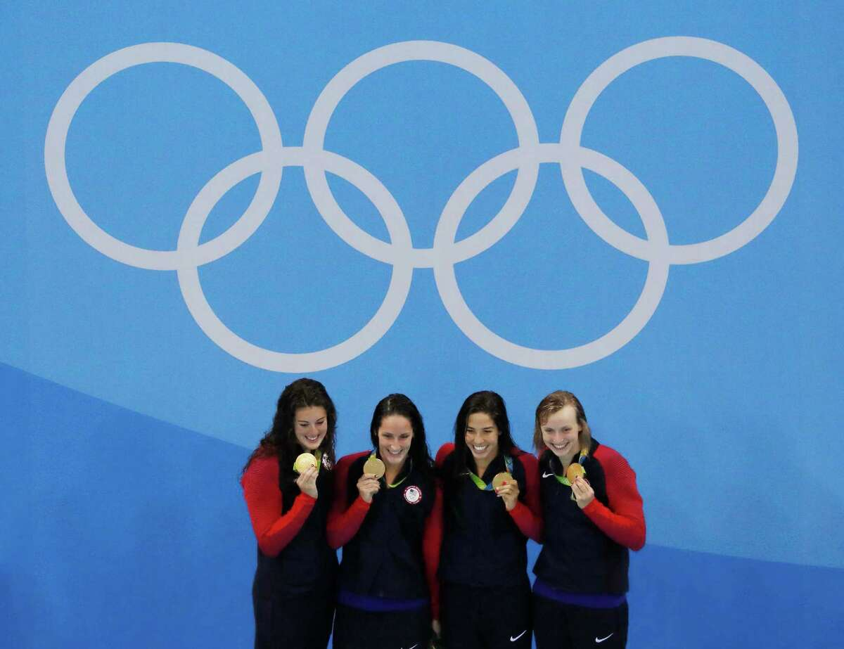 United States' Allison Schmitt, Leah Smith, Maya Dirado and Katie Ledecky celebrate after winning agold medal in the 4 x 200m freestyle relay finals during to the swimming competitions at the 2016 Summer Olympics, Thursday, Aug. 11, 2016, in Rio de Janeiro, Brazil. (AP Photo/Morry Gash) ORG XMIT: OLMG163