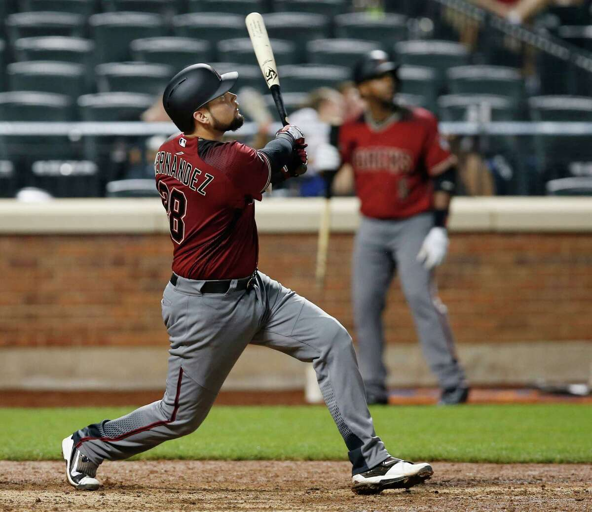 Arizona Diamondbacks Oscar Hernandez watches his 12th-inning solo home run off New York Mets relief pitcher Jerry Blevins in a baseball game, Wednesday, Aug. 10, 2016, in New York. (AP Photo/Kathy Willens) ORG XMIT: NYM122