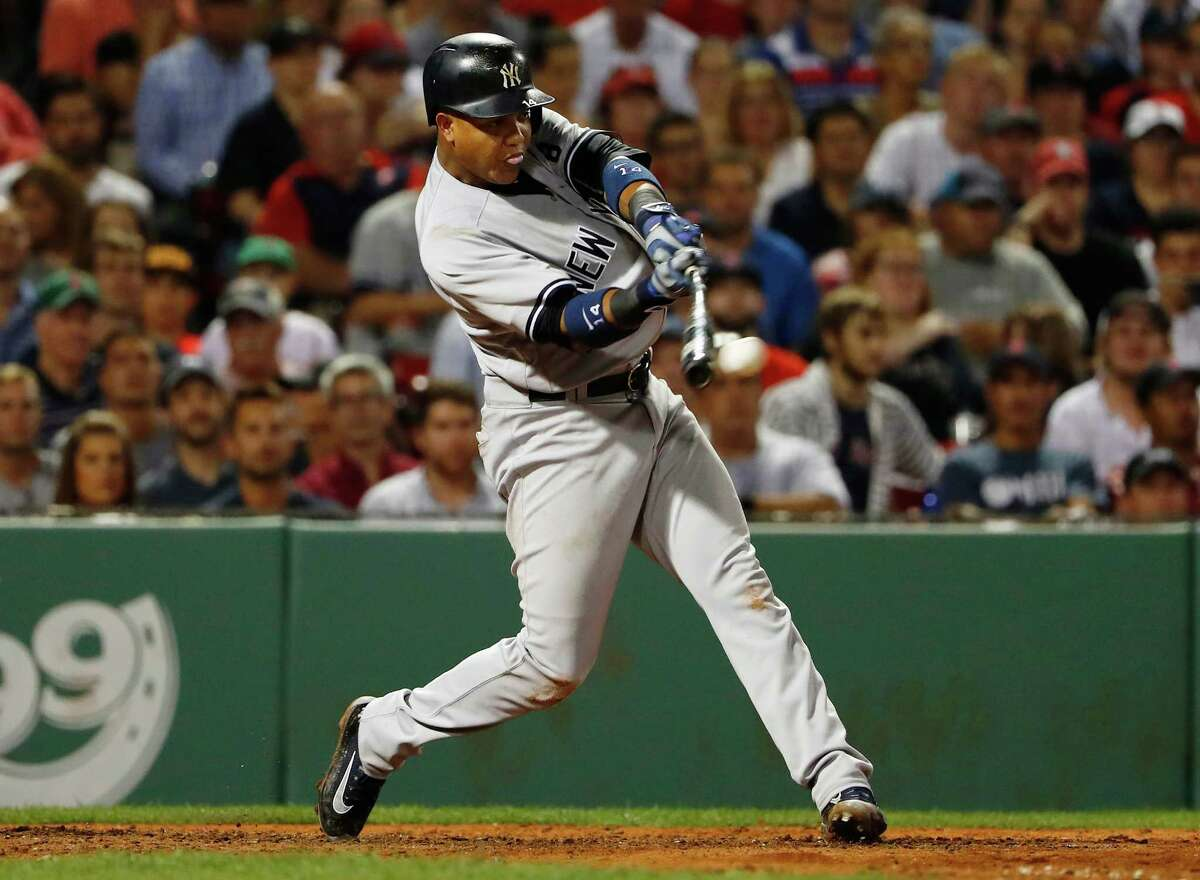 New York Yankees' Starlin Castro connects on a two-run go ahead double against the Boston Red Sox during the seventh inning of a baseball game at Fenway Park in Boston Wednesday, Aug. 10, 2016. (AP Photo/Winslow Townson) ORG XMIT: BXF121
