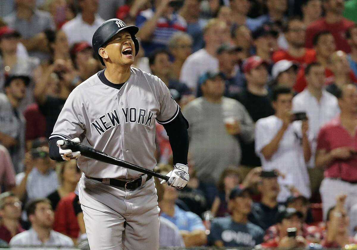 BOSTON, MA - AUGUST 10: Alex Rodriguez #13 of the New York Yankees reacts after flying out in the seventh inning against the Boston Red Sox with runners in scoring position at Fenway Park on August 10, 2016 in Boston, Massachusetts. (Photo by Jim Rogash/Getty Images) ORG XMIT: 607683309