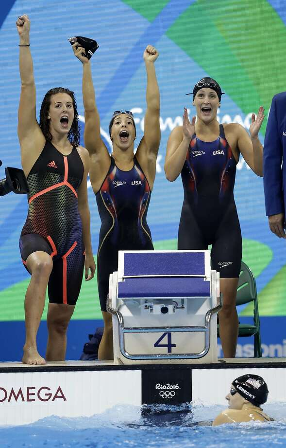 Katie Ledecky, bottom, finishes the race as her teammates Allison Schmitt, Maya DiRado and Leah Smith, from left, celebrate their gold-medal relay win. Photo: Michael Sohn, Associated Press