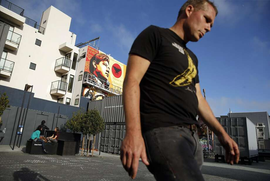 Shepard Fairey paints a mural in the Hayes Valley neighborhood of San Francisco. Photo: Scott Strazzante, The Chronicle