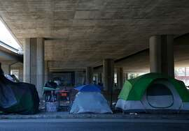 Tents can be seen underneath an overpass on Brush street Aug. 10, 2016 in Oakland, Calif.