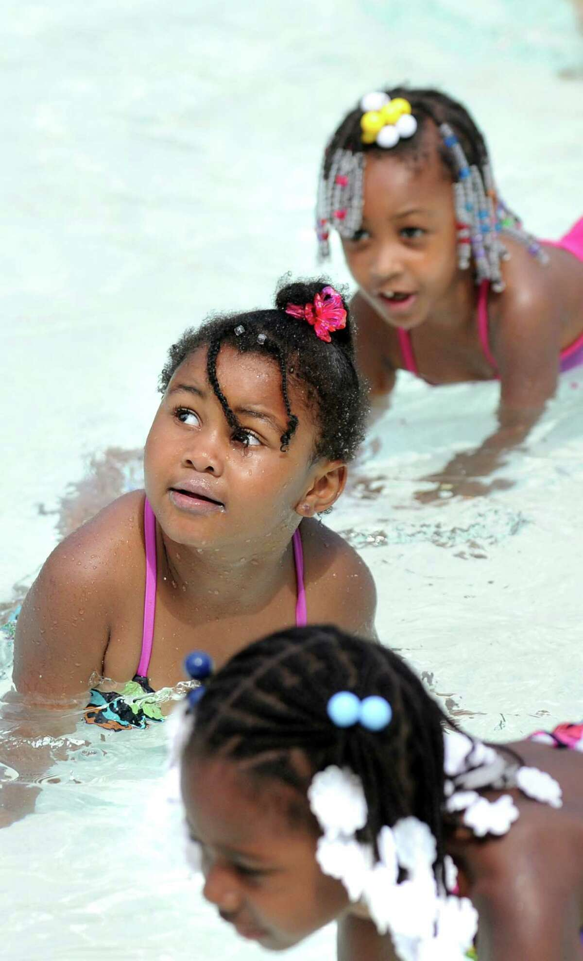 Children from kindergarten to sixth grade take part in a Learn-to-Swim lesson on Wednesday, July 9, 2014, at Lincoln Park Pool in Albany, N.Y. The free, 10-program is put on by the City of Albany and the American Red Cross and sponsored by Tri City Rentals. (Cindy Schultz / Times Union)