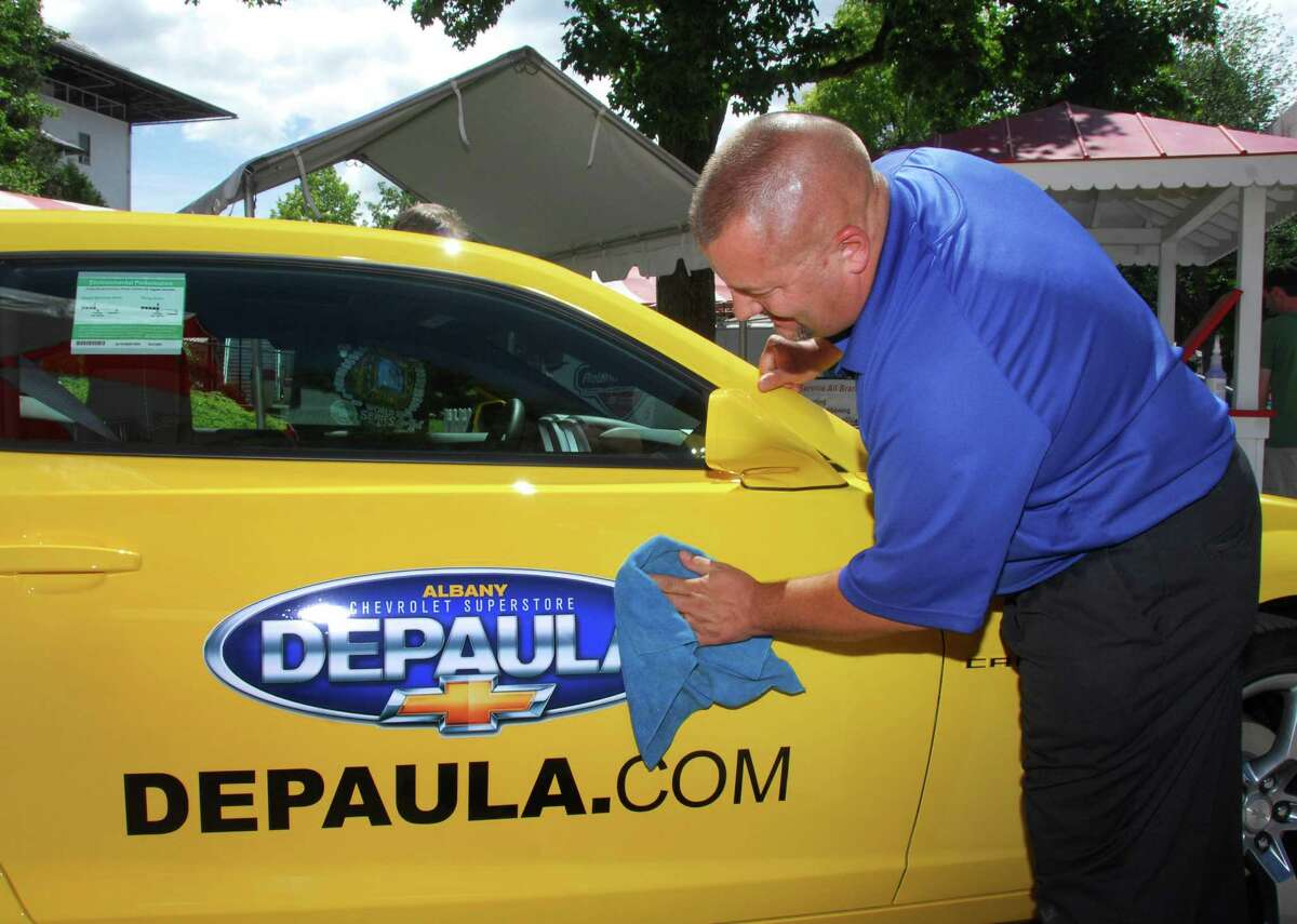 Dan Wheeler Sr., of Depaula Chevrolet of Albany details a 2010 Camaro SS at his company's display booth at Saratoga Race Course Thursday afternoon July 22, 2010. (John Carl D'Annibale / Times Union)