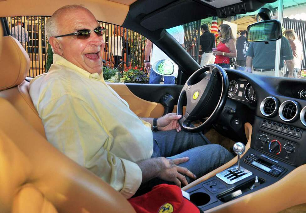 Anthony DePaula of Saratoga Springs inside his 2001 Ferrari 550 Marinello during ceremonies to kick off the 11th Annual Saratoga Wine & Food and Fall Ferrari Festival at SPAC Friday Sept. 9, 2011. (John Carl D'Annibale / Times Union)