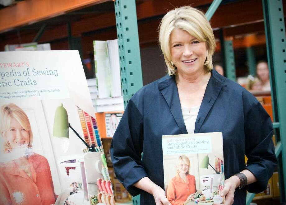 """Martha Stewart signs copies of her new book, """"Martha Stewart's Encyclopedia of Sewing and Fabric Crafts"""" and bestsellers """"Martha Stewart's Encyclopedia of Crafts"""" and """"Everyday Food: Fresh Flavor East"""" at Costco in Norwalk, Conn. on Thursday April 29, 2010. Photo: Kathleen O'Rourke / Stamford Advocate"""